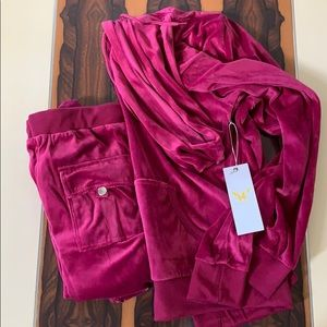 Fuchsia colored velour jump suit